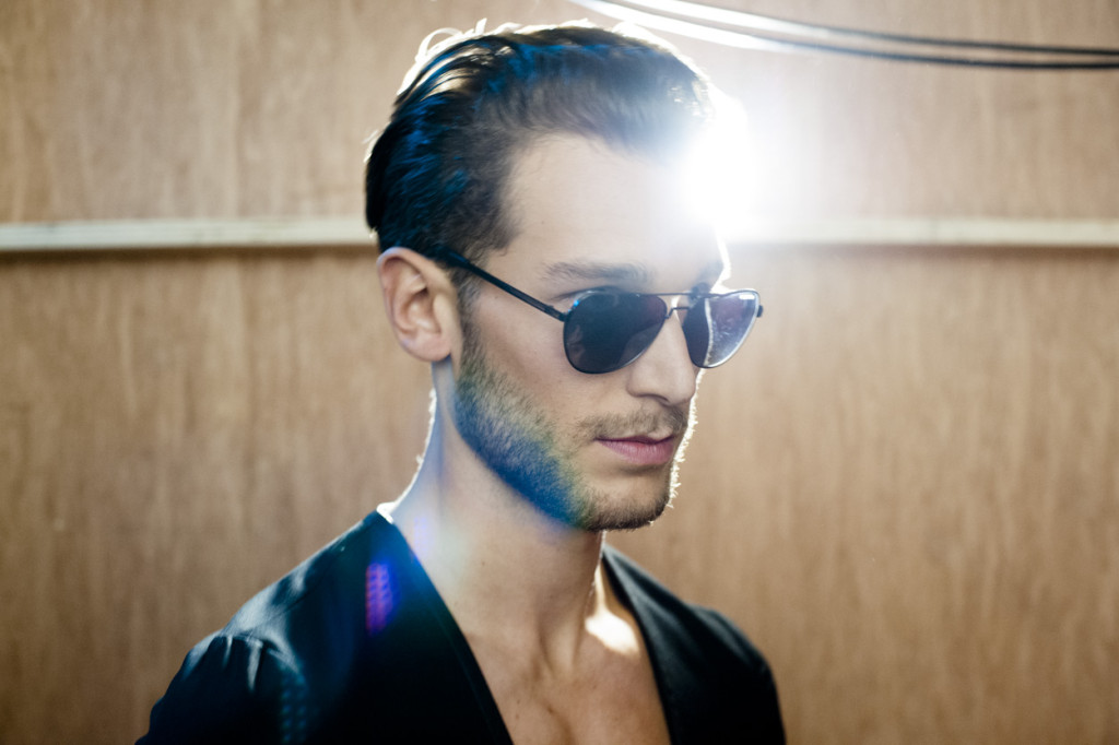 A backstage portrait before he hits the runway. Shot of model backstage at HD Homme show, October 2014.
